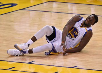 Golden State Warriors' Draymond Green (23) falls to the ground after shooting a basket against the Utah Jazz during the fourth quarter of Game 2 of their NBA second-round playoff series at Oracle Arena in Oakland, Calif. on Thursday, May 4, 2017. Green would leave the game. (Jose Carlos Fajardo/Bay Area News Group)