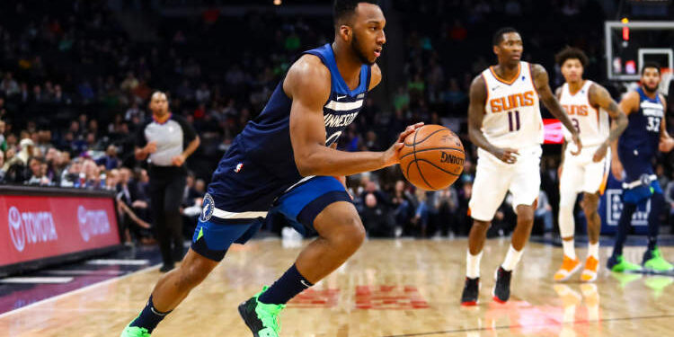 MINNEAPOLIS, MN - JANUARY 20: Josh Okogie #20 of the Minnesota Timberwolves dribbles the ball in the fourth quarter against the Phoenix Suns at Target Center on January 20, 2019 in Minneapolis, Minnesota. The Minnesota Timberwolves defeated the Phoenix Suns 116-114. NOTE TO USER: User expressly acknowledges and agrees that, by downloading and or using this Photograph, user is consenting to the terms and conditions of the Getty Images License Agreement. (Photo by David Berding/Getty Images)